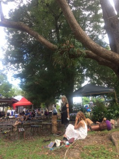 locals chilling out in Nimbin market