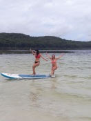 Attempting paddle boarding